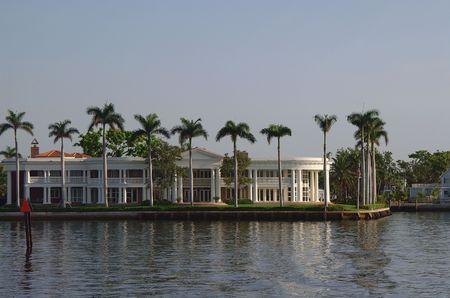 White Luxury house along Canal. Surrouned by Palm trees Reklamní fotografie