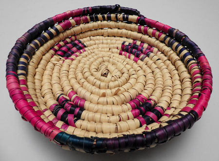 weavers: A handwoven Haitian basket. This basket was made by native weavers in Haiti circa 1992.