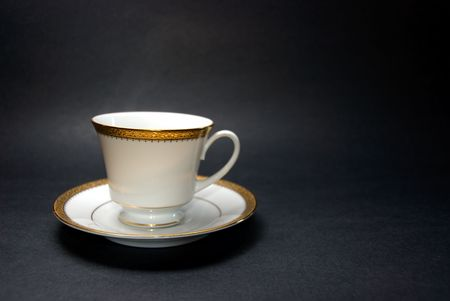 Teacup and Saucer on Black Background