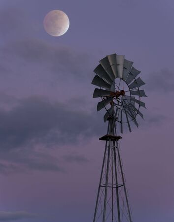 Lunar Eclipse over Windmill. Located in Napa Valley California Stock Photo