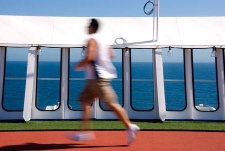 Jogger blurred running around track on cruise ship