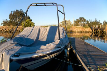 Partially covered ski boat