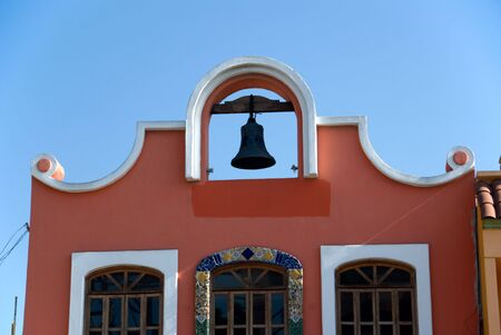 Spanish style building in Tijuana Mexico with bell