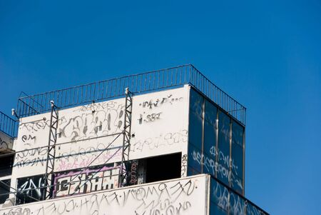 Building in Tijuana Mexico with graffiti written all over it.