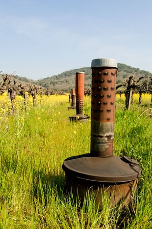 Smudge pots in Napa California used during low temps to keep vineyards from freezing