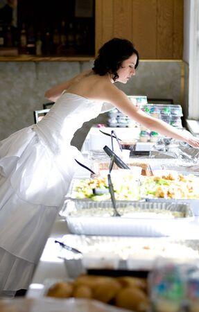 Bride getting food