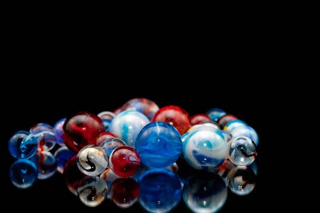 Group of marbles made of glass with swirls and various colors