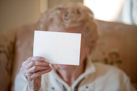 post card: Post Card being held by elderly woman