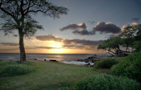 Sunsetting on the coast of Oahu, Hawaii in the city of Ko Olina Stock Photo