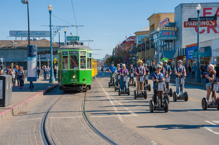 San Francisco, CA - February 03: Tourists tour San Franciscos Fishermans Wharf area on Segways Editorial