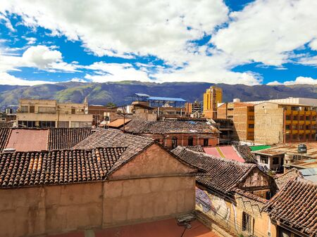 A background from the old part of the city, where the roofs from buildings from the 1910's can bee seen with a cloudy background. Stock Photo