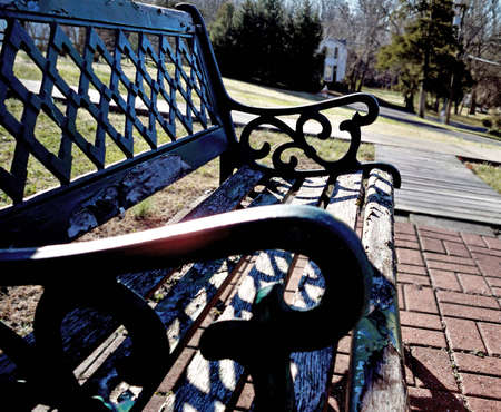 old park bench with peeling paint