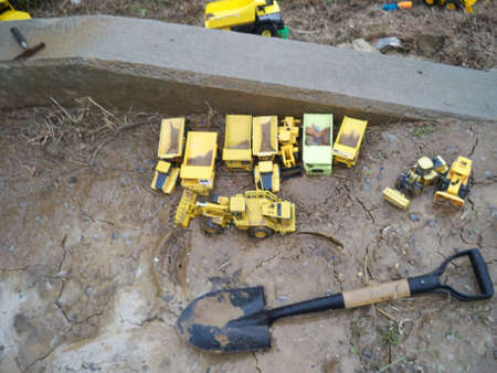 construction toys in the mud