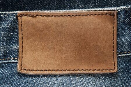 denim: Etiqueta de pantalones de cuero en blanco Foto de archivo