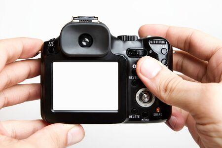 taking photograph: Taking photo with compact camera