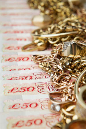 Golden jewelry on British Pounds