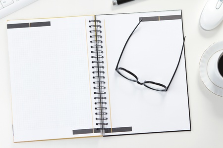 Blank note at the office desk photo