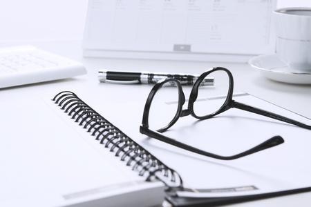 White office desk, break at work concept photo