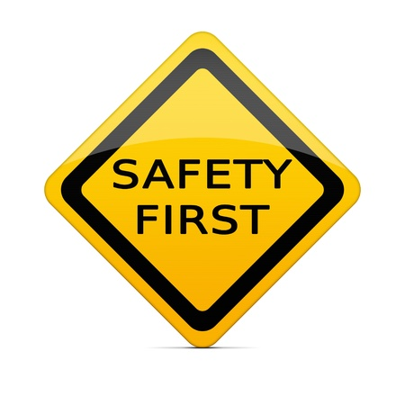 construction safety: SAFETY FIRST sign on white with clipping path Stock Photo
