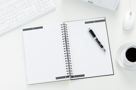 office furniture: Blank note at the office desk