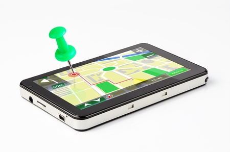 gps: Travel destination, green pin stuck in a GPS device