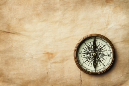 Vintage compass on old paper sheet with copy space Stock Photo - 10378892