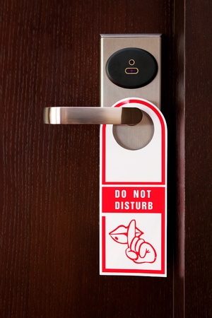 hotel door: Hotel door handle with do not disturb sign