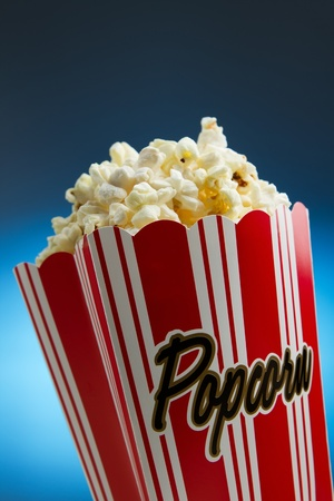 Popcorn over blue background photo