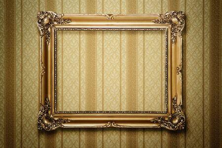 Grunge gold wooden frame on striped wallpaper photo