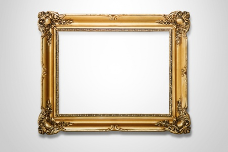frame photo: Grunge gold wooden frame on white wall, clipping path included