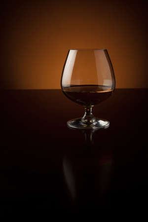 Glass of cognac with copy space photo
