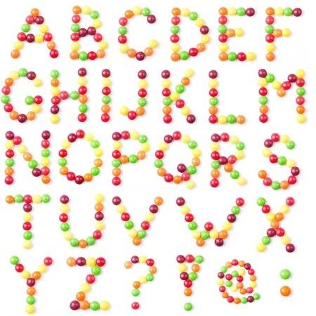 Candies alphabet on white background Stock Photo - 10675340