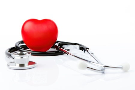 Red heart and a stethoscope on white background Stock Photo - 10675342