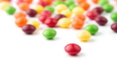 Colorful fruit candies on white background  photo