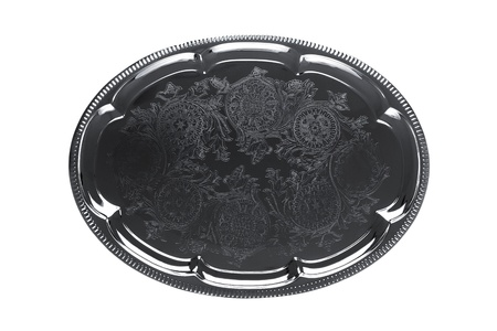 Top view of an empty silver tray with floral ornament isolated on white photo
