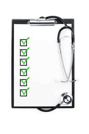 medical notes: Clipboard with checklist and stethoscope isolated with path included Stock Photo