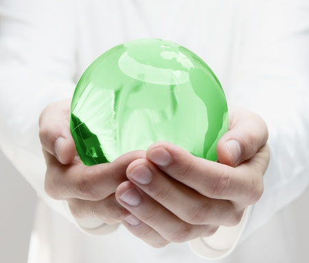hands holding globe: Green earth in human hands Stock Photo