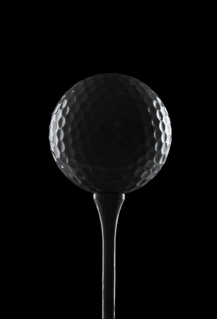 Golf ball on black background photo