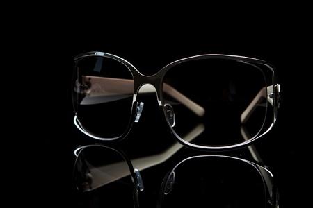 protective spectacles: Elegant sunglasses on black background