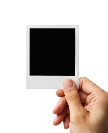 hand holding paper: Male hand holding blank instant photo frame, clipping path included Stock Photo
