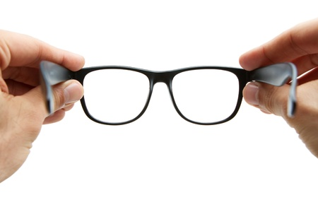 eyes open: Human hands holding retro style eyeglasses