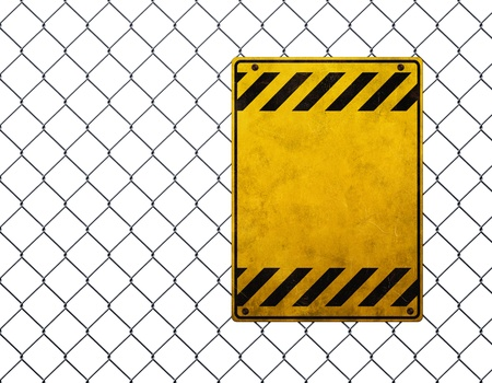 chain fence: Empty yellow warning sign at chainlink fence
