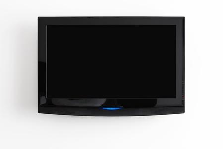 Flat screen LCD-opknoping op de muur met het knippen van weg voor het scherm Stockfoto