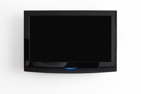 Pantalla plana LCD colgada en la pared con trazado de recorte para la pantalla Foto de archivo