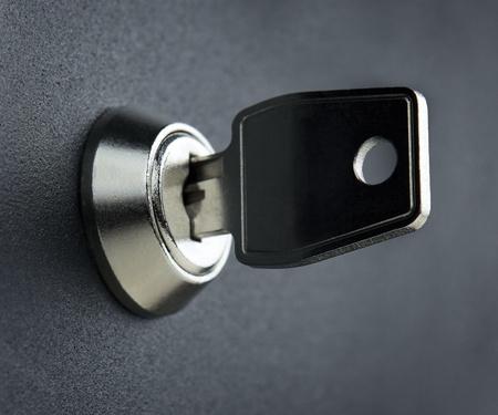 safety deposit box: Key in the deposit box keyhole