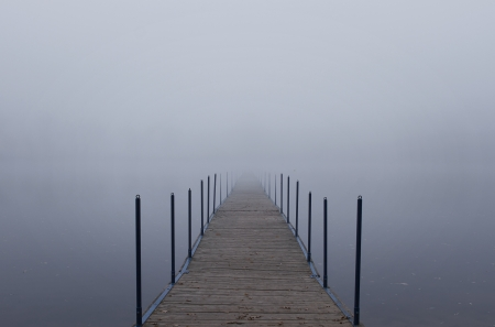 dream lake: Endless jetty into a fog Stock Photo