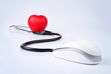 Computer mouse connected to the stethoscope Stock Photo - 11225067