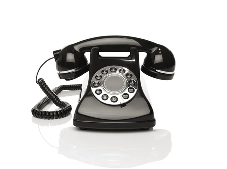 Vintage phone on white background photo