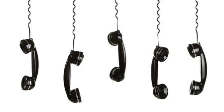 Rotary telefoontoestellen opknoping in de lucht op wit wordt geïsoleerd
