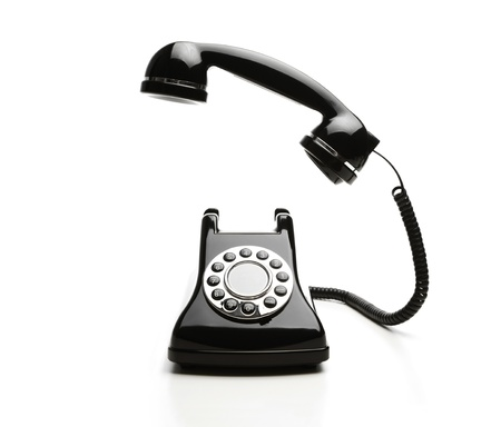old fashioned rotary phone: Old fashioned telephone on white background